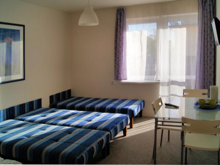 Pokój 4 os z łazienką i balkonem