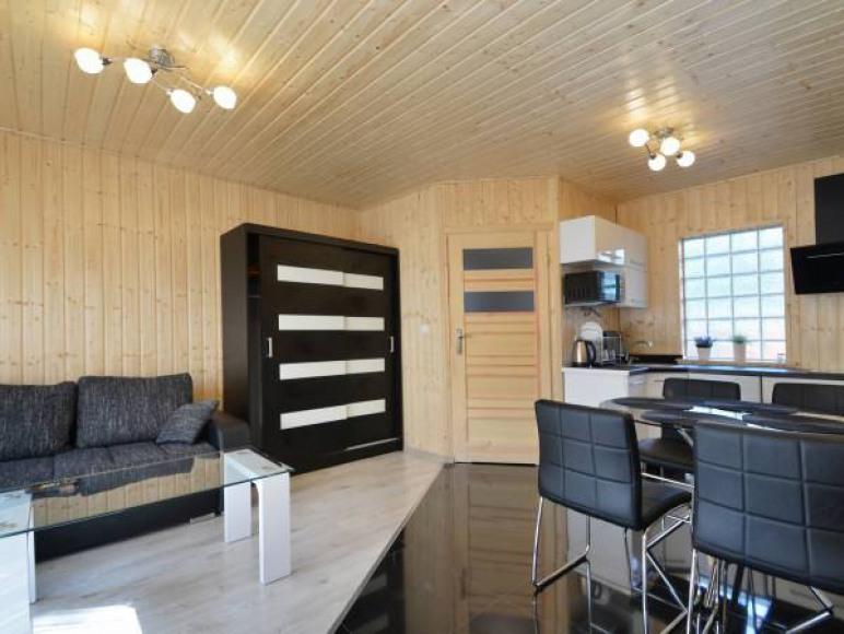 salon z aneksem komfortowego domku rodzinnego 4-5 os.