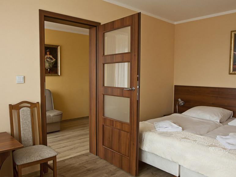 Apartament typu Studio Rodzinne sypialnia