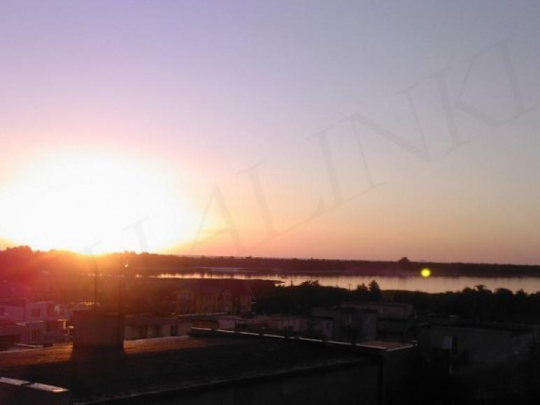 Wschód słońca z balkonu naszego domu.