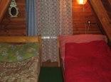Domek 30 z sauną fińską i kominkiem nad jeziorem