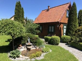 Mazurski domek w ogrodzie