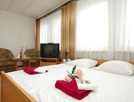 Sypialnia w apartamencie małym